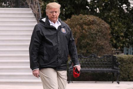 U.S. President Donald Trump walks out to talk to reporters as he departs for travel to Alabama and Florida from the White House in Washington, U.S. March 8, 2019.  REUTERS/Jonathan Ernst