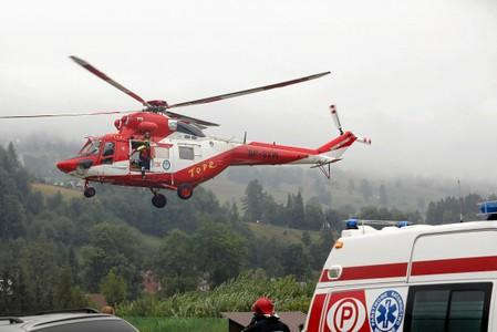 TOPR (Tatra Volunteer Search and Rescue) helicopter takes part in a rescue operation after a thunderstorm in the Tatra Mountains, in Zakopane