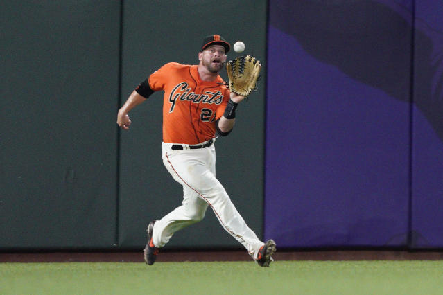 San Francisco Giants left fielder Stephen Vogt catches a fly ball for the out on Miami Marlins' Miguel Rojas during the fourth inning of a baseball game Friday, Sept. 13, 2019, in San Francisco. (AP Photo/Tony Avelar)