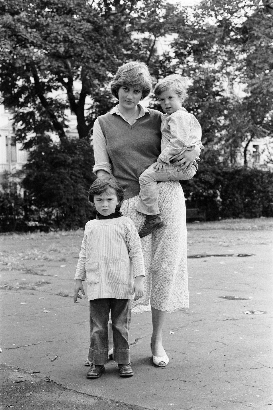 <p>Diana worked as a nursery school assistant in London before she married Prince Charles in 1981. Here, she is photographed with some of her students in the park. </p>