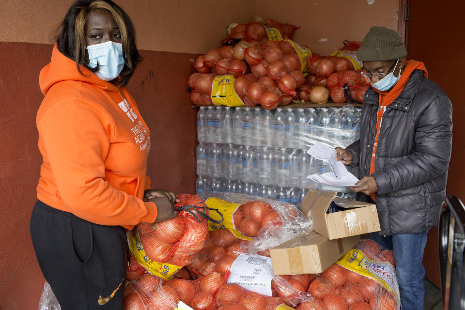 BROOKLYN, NY - APRIL 23: Volunteers at the food pantry Bed Stuy Campaign Against Hunger distribute free food to local residents during the COVID-19 pandemic on April 23, 2020 in the Bedford-Stuyvesant neighborhood of Brooklyn, New York. Due to increased levels of unemployment, the lines at the daily food pantry have been getting longer. (Photo by Andrew Lichtenstein/Corbis via Getty Images)