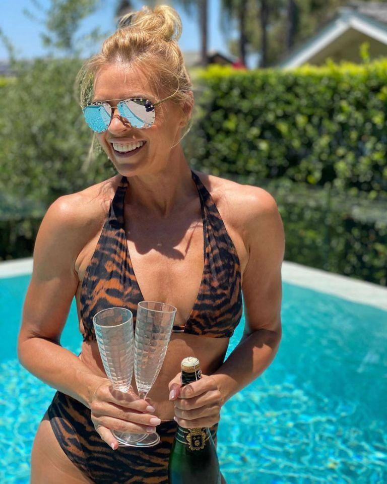 Sonia sizzled in a leopard-print bikini poolside. Photo: Instagram/soniakruger.