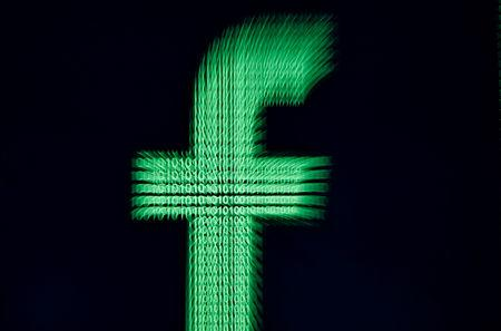 FILE PHOTO: A 3D-printed Facebook logo is displayed in front of binary digits in this illustration