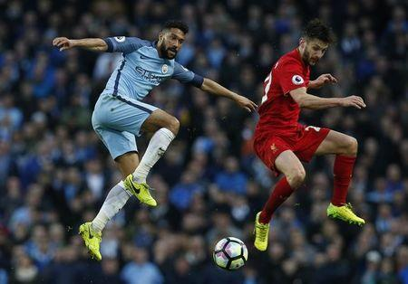 Britain Soccer Football - Manchester City v Liverpool - Premier League - Etihad Stadium - 19/3/17 Liverpool's Adam Lallana in action with Manchester City's Gael Clichy  Reuters / Andrew Yates Livepic