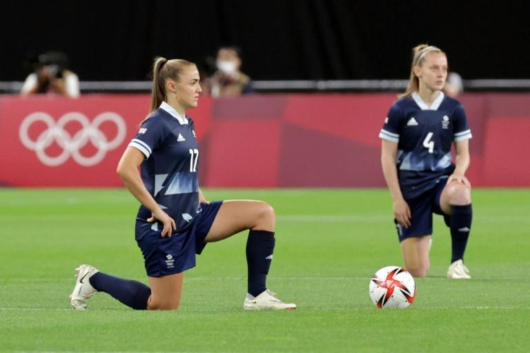 Great Britain forward Georgia Stanway (L) and midfielder Keira Walsh take a knee before their win over Chile