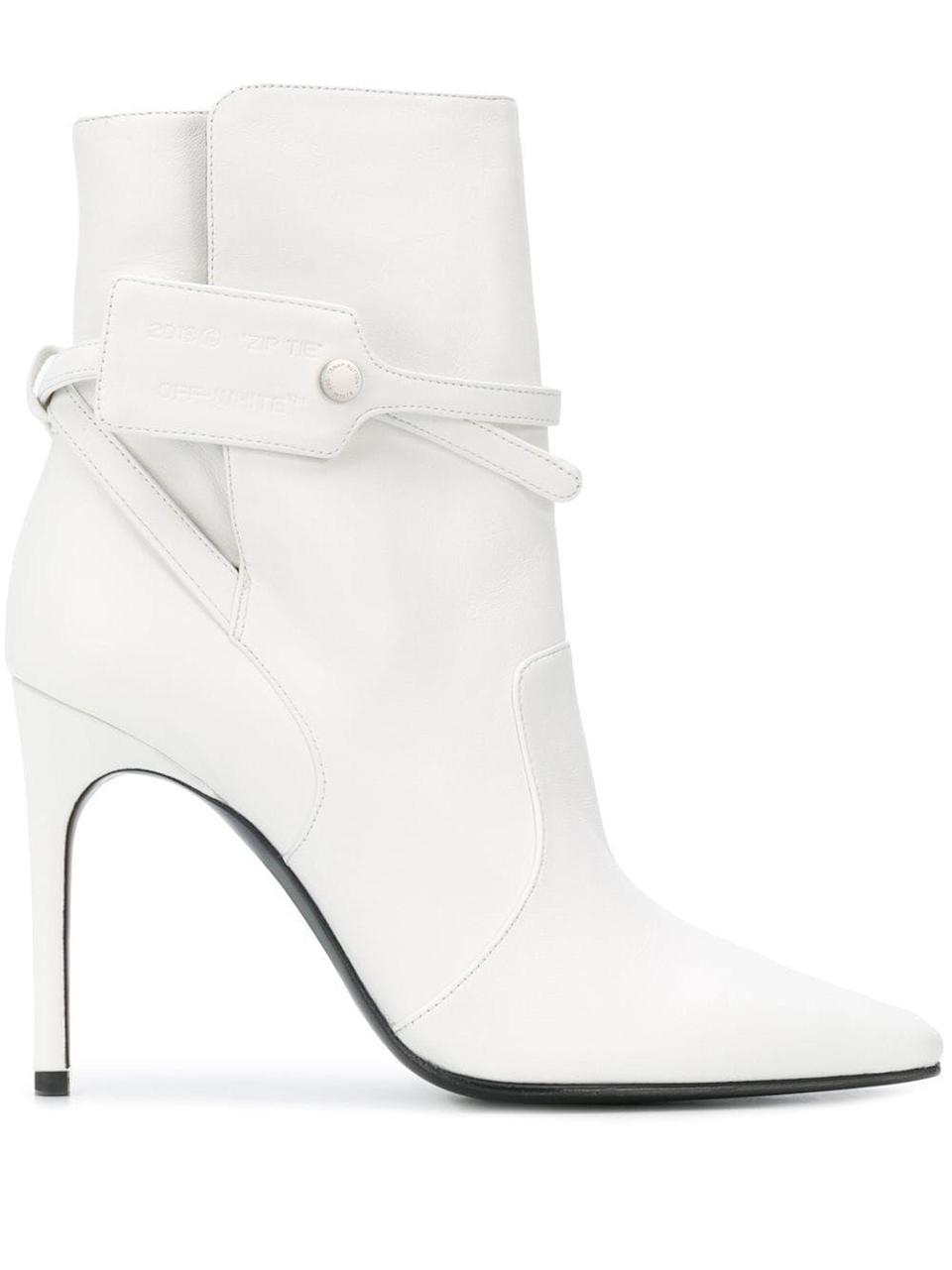 """<p><strong>Off-White</strong></p><p>farfetch.com</p><p><strong>$570.00</strong></p><p><a href=""""https://go.redirectingat.com?id=74968X1596630&url=https%3A%2F%2Fwww.farfetch.com%2Fshopping%2Fwomen%2Foff-white-security-tag-ankle-boots-item-15353238.aspx&sref=https%3A%2F%2Fwww.harpersbazaar.com%2Ffashion%2Ftrends%2Fg7958%2Fhow-to-wear-ankle-boots%2F"""" rel=""""nofollow noopener"""" target=""""_blank"""" data-ylk=""""slk:Shop Now"""" class=""""link rapid-noclick-resp"""">Shop Now</a></p><p>Pair Off-White's white bootie effortlessly with all your fall dresses.</p>"""