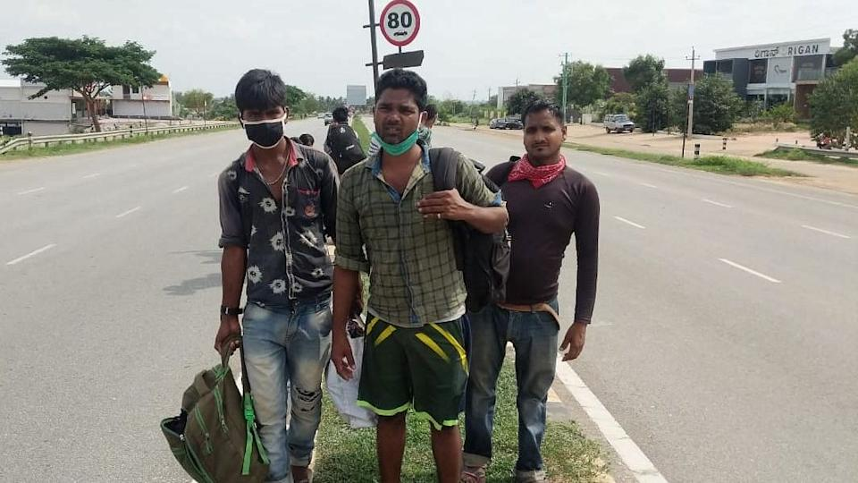 Salman Khan (on the left) as he was walking back home from Bengaluru to UP.