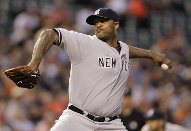 New York Yankees pitcher CC Sabathia delivers the ball to the Baltimore Orioles during the first inning of a baseball game, Monday, Sept. 9 2013, in Baltimore. (AP Photo/Luis M. Alvarez)