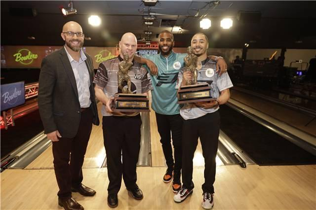 Mookie Betts, right, and partner Tommy Jones hold their trophies after winning Chris Paul's celebrity bowling event in 2019. (Courtesy of PBA)