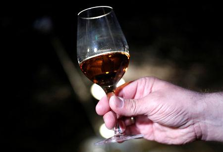 Zoltan Kovacs, general manager of the Royal Tokaji Wine Company shows a glass of Royal Tokaji Essencia in Mad, Hungary, April 12, 2019. Picture taken April 12, 2019. REUTERS/Bernadett Szabo