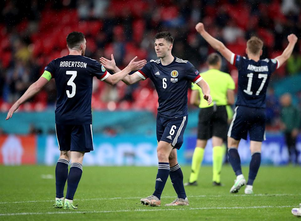 Andrew Robertson and Kieran Tierney react after the match (PA)