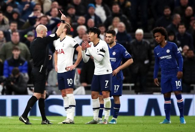 Anthony Taylor shows Son Heung-min a red card for kicking Antonio Rudiger in a separate incident (Nick Potts/PA)