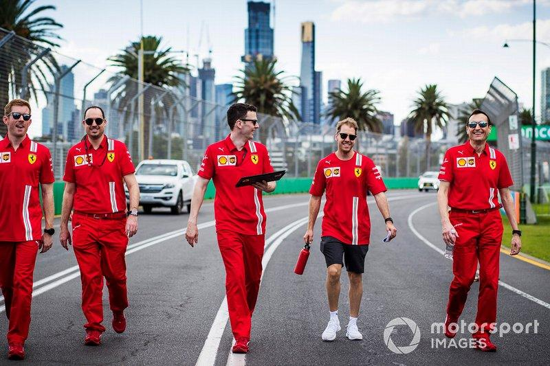 "Sebastian Vettel, Ferrari walks the track with members of the team<span class=""copyright"">Sam Bloxham / Motorsport Images</span>"