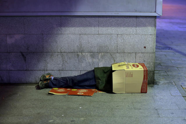 <p>A man sleeps inside a cardboard box in Madrid, Oct. 28, 2013. (AP Photo/Andres Kudacki) </p>