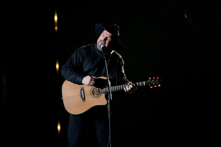 Singer-songwriter Garth Brooks performs onstage during the 52nd annual CMA Awards, where he paid tribute to those shot at a country music bar in California