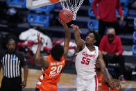 Syracuse forward Robert Braswell (20) shoots on Houston forward Brison Gresham (55) in the first half of a Sweet 16 game in the NCAA men's college basketball tournament at Hinkle Fieldhouse in Indianapolis, Saturday, March 27, 2021. (AP Photo/Michael Conroy)