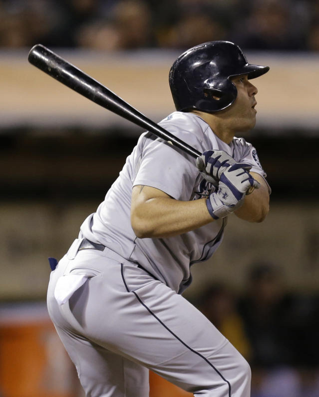 Seattle Mariners' Kendrys Morales swings for an RBI fielder's choice against the Oakland Athletics' in the eighth inning of a baseball game Tuesday, Aug. 20, 2013, in Oakland, Calif. (AP Photo/Ben Margot)
