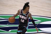 Memphis Grizzlies' Ja Morant (12) handles the ball in the first half of an NBA basketball game against the Dallas Mavericks in Dallas, Monday, Feb. 22, 2021. (AP Photo/Tony Gutierrez)