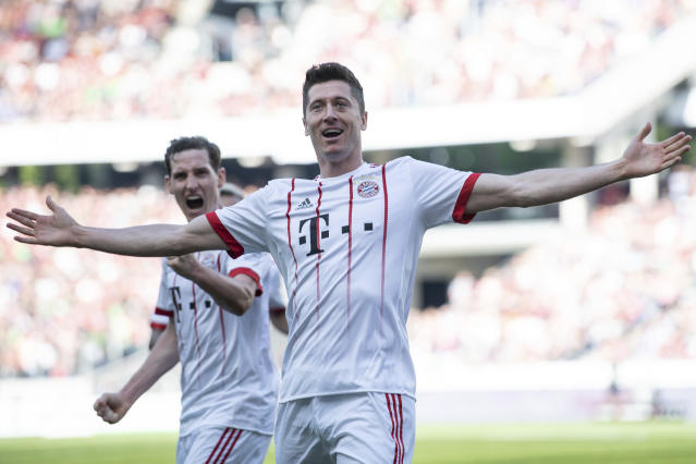 Bayern's Robert Lewandowski, front and Sebastian Rudy celebrate a goal during a German Bundesliga soccer match between Hannover 96 and Bayern Munich in Hannover, Germany, Saturday, April 21, 2018 (Swen Pfoertner/dpa via AP)