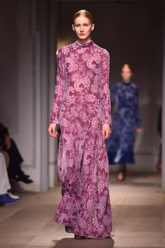 <p>Trust Erdem to demontrate how to wear floor-skimming dresses in fuchsia this season. When on the hunt for new garms, keep an eye out for mandarin collars and lengthy sleeves. <em>[Photo: PA]</em> </p>