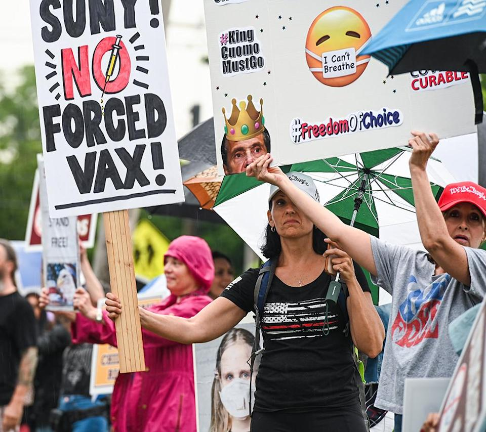 A crowd protesting mandatory masks and vaccines forms before a school board meeting at a high school in Kings Park, New York on June 8. (Steve Pfost/Newsday RM via Getty Images)