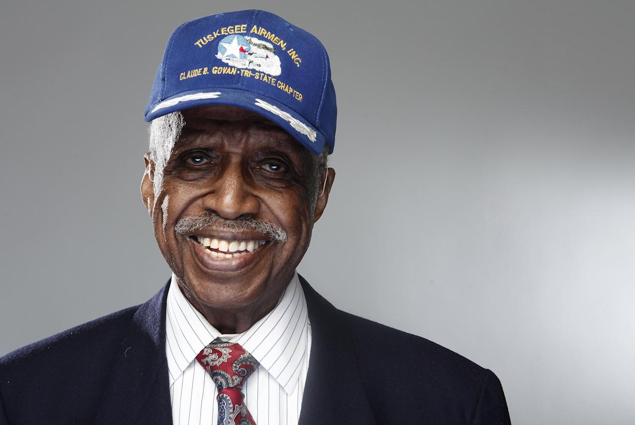 "In this Jan. 10, 2012 photo, Tuskegee airman Theobald G. Wilson poses for a portrait during the ""Red Tails"" press junket in New York. ""Red Tails,"" a film that chronicles the heroism of the Tuskegee Airmen, opens Friday, Jan. 20. (AP Photo/Carlo Allegri)"