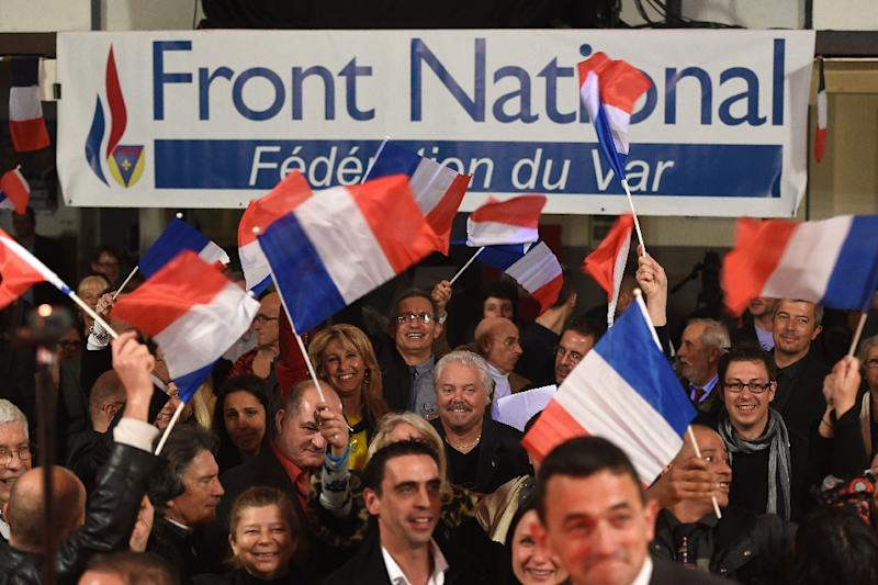 French far-right National Front (FN) party supporters react after the announcement of results in the first round of the French departemental elections, on March 22, 2015 in La Valette-du-Var (AFP Photo/Boris Horvat)