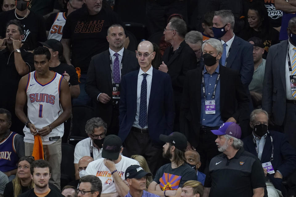 NBA Commissioner Adam Silver, center, watches during the first half of Game 5 of basketball's NBA Finals between the Phoenix Suns and the Milwaukee Bucks, Saturday, July 17, 2021, in Phoenix. (AP Photo/Ross D. Franklin)