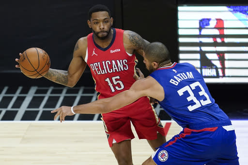 Los Angeles Clippers forward Nicolas Batum (33) defends against New Orleans Pelicans guard Sindarius Thornwell (15) during the first quarter of an NBA basketball game Wednesday, Jan. 13, 2021, in Los Angeles. (AP Photo/Ashley Landis)