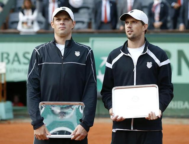 US Bob Bryan (R) and US Mike Bryan (L) pose with a trophy after losing to Belarus Max Mirnyi and Canada's Daniel Nestor during Men's Doubles final tennis match of the French Open tennis tournament at the Roland Garros stadium, on June 9, 2012 in Paris. AFP PHOTO / THOMAS COEXTHOMAS COEX/AFP/GettyImages