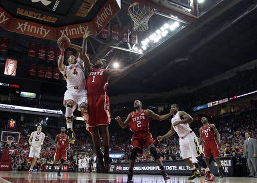 Maryland guard Seth Allen (4) shoots over North Carolina State forward Richard Howell (1) in the first half of an NCAA college basketball game in College Park, Md., Wednesday, Jan. 16, 2013. (AP Photo/Patrick Semansky)