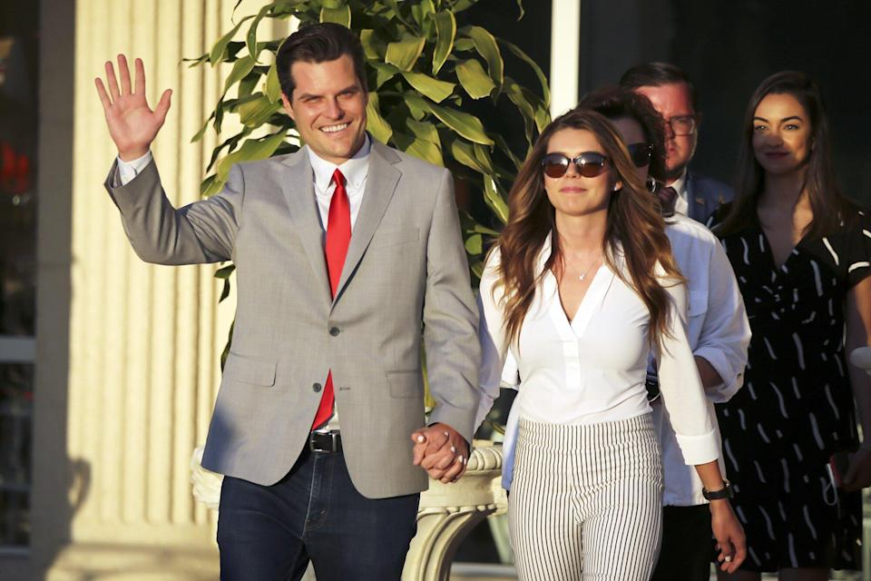 Representative Matt Gaetz, a Republican from Florida, waves as he arrives with his fiancee, Ginger Luckey, for the Save America Summit in Doral, Florida, U.S., on Friday, April 9, 2021