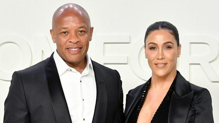 """Andre """"Dr. Dre"""" Young (left) and Nicole Young (right) pose for the cameras back in February 2020 at the Tom Ford AW20 Show at Milk Studios in Hollywood. (Photo by Amy Sussman/Getty Images)"""