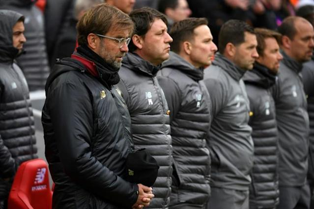 Liverpool manager Jurgen Klopp and his staff observe a minute's silence to mark 30 years since the Hillsborough disaster, in April 2019 (AFP Photo/Paul ELLIS )