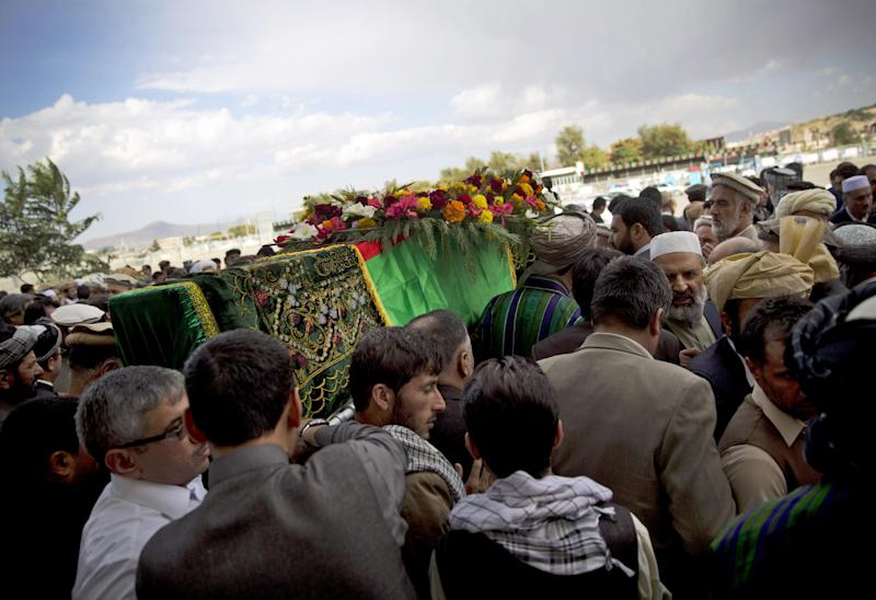 Afghan men carry the coffin of slain Afghan governor Arsallah Jamal out of the Eid Gha mosque in Kabul, Afghanistan, Thursday, Oct 17, 2013. Afghan officials, dignitaries and family members attended the funeral of the governor of eastern Logar province, who was killed in an insurgent attack earlier this week. (AP Photo/Anja Niedringhaus)