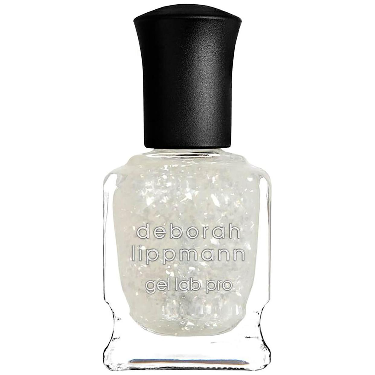 """<h3>Deborah Lippmann Nail Polish in This Magic Moment</h3> <br>When your go-to polish — be it <a href=""""https://www.refinery29.com/en-us/best-gray-nail-polish"""" rel=""""nofollow noopener"""" target=""""_blank"""" data-ylk=""""slk:slate gray"""" class=""""link rapid-noclick-resp"""">slate gray</a> or <a href=""""https://www.refinery29.com/en-us/best-pink-nail-polish"""" rel=""""nofollow noopener"""" target=""""_blank"""" data-ylk=""""slk:pale pink"""" class=""""link rapid-noclick-resp"""">pale pink</a> — isn't packing that fresh, fun punch you're looking for, try layering on a glitter topcoat for some pizzazz. """"I love This Magic Moment by Deborah Lippmann,"""" says Tuttle. """"Because it's sheer white mica, you can swipe it over <em>any</em> polish base for a fresh, shiny finish.""""<br><br><strong>Deborah Lippmann</strong> Nail Polish in This Magic Moment, $, available at <a href=""""https://www.deborahlippmann.com/this-magic-moment"""" rel=""""nofollow noopener"""" target=""""_blank"""" data-ylk=""""slk:Deborah Lippmann"""" class=""""link rapid-noclick-resp"""">Deborah Lippmann</a><br>"""
