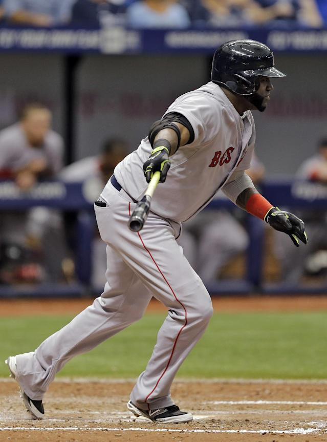 Boston Red Sox's David Ortiz follows through on an RBI-single off Tampa Bay Rays relief pitcher Joel Peralta during the eighth inning of a baseball game Sunday, Aug. 31, 2014, in St. Petersburg, Fla. Red Sox's Mookie Betts scored on the hit. (AP Photo/Chris O'Meara)