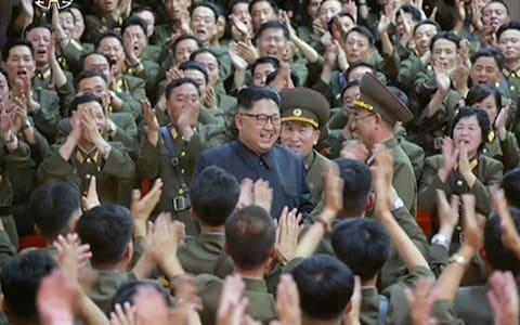 North Korean leader Kim Jong Un is seen being applauded at a performance in Pyongyang, in footage released on Tuesday - Credit: AP