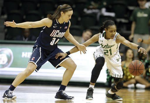 South Florida guard Andrea Smith (21) reaches for the ball after having it tipped away by Connecticut guard Kelly Faris (34) during the first half of an NCAA women's college basketball game Saturday, March 2, 2013, in Tampa, Fla. (AP Photo/Chris O'Meara)