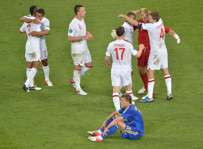 England's players celebrate after the the Euro 2012 football championships match England vs Ukraine on June 19, 2012 at the Donbass Arena in Donetsk.  AFP PHOTO / SERGEI SUPINSKYSERGEI SUPINSKY/AFP/GettyImages