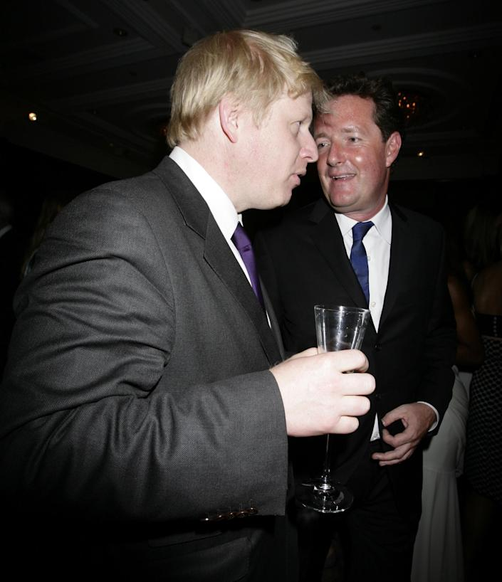 Mayor of London Boris Johnson (left) with Piers Morgan during a party to celebrate the 180th Anniversary of weekly politics magazine The Spectator, held at the Churchill Hyatt Hotel in central London.   (Photo by Yui Mok - PA Images/PA Images via Getty Images)