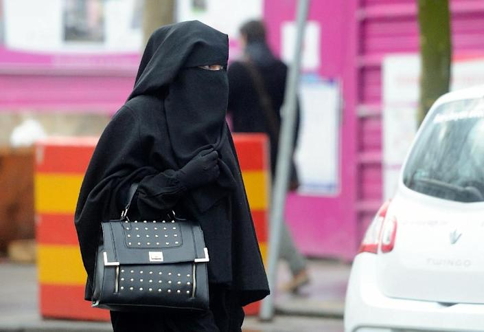 A woman wearing a niqab as she walks in a street in the center of Roubaix, northern France in 2014 (AFP Photo/Philippe Huguen)