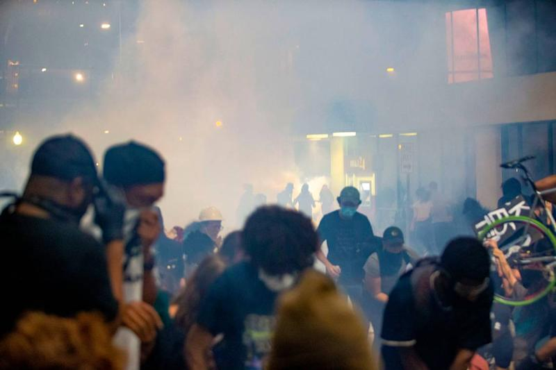 Tear gas clouds envelops protesters who said they were trapped on 4th Street by police, who unleased a barrage of chemical agents.
