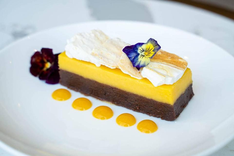 IRO's desserts include a Passionfruit Mousse Cake atop a brownie with passionfruit coulis and meringue.