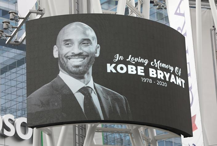 An image of Kobe Bryant is shown on a large screen outside the Staples Center after the retired Los Angeles Lakers basketball star was killed in a helicopter crash, in Los Angeles, California, U.S. January 26, 2020. REUTERS/Monica Almeida