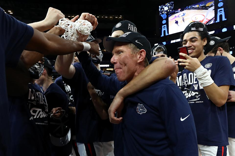 INDIANAPOLIS, INDIANA - MARCH 30: Head coach Mark Few of the Gonzaga Bulldogs celebrates with the net after defeating the USC Trojans 85-66 in the Elite Eight round game of the 2021 NCAA Men's Basketball Tournament at Lucas Oil Stadium on March 30, 2021 in Indianapolis, Indiana. (Photo by Jamie Squire/Getty Images)
