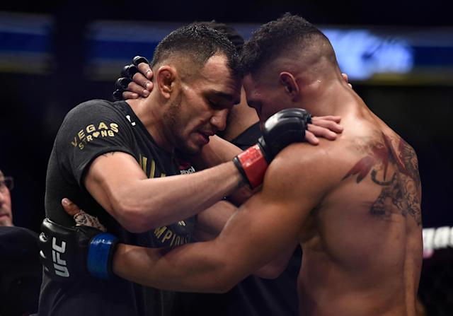 Tony Ferguson (L) and Kevin Lee embrace after their UFC 216 fight on Saturday night. (Getty)