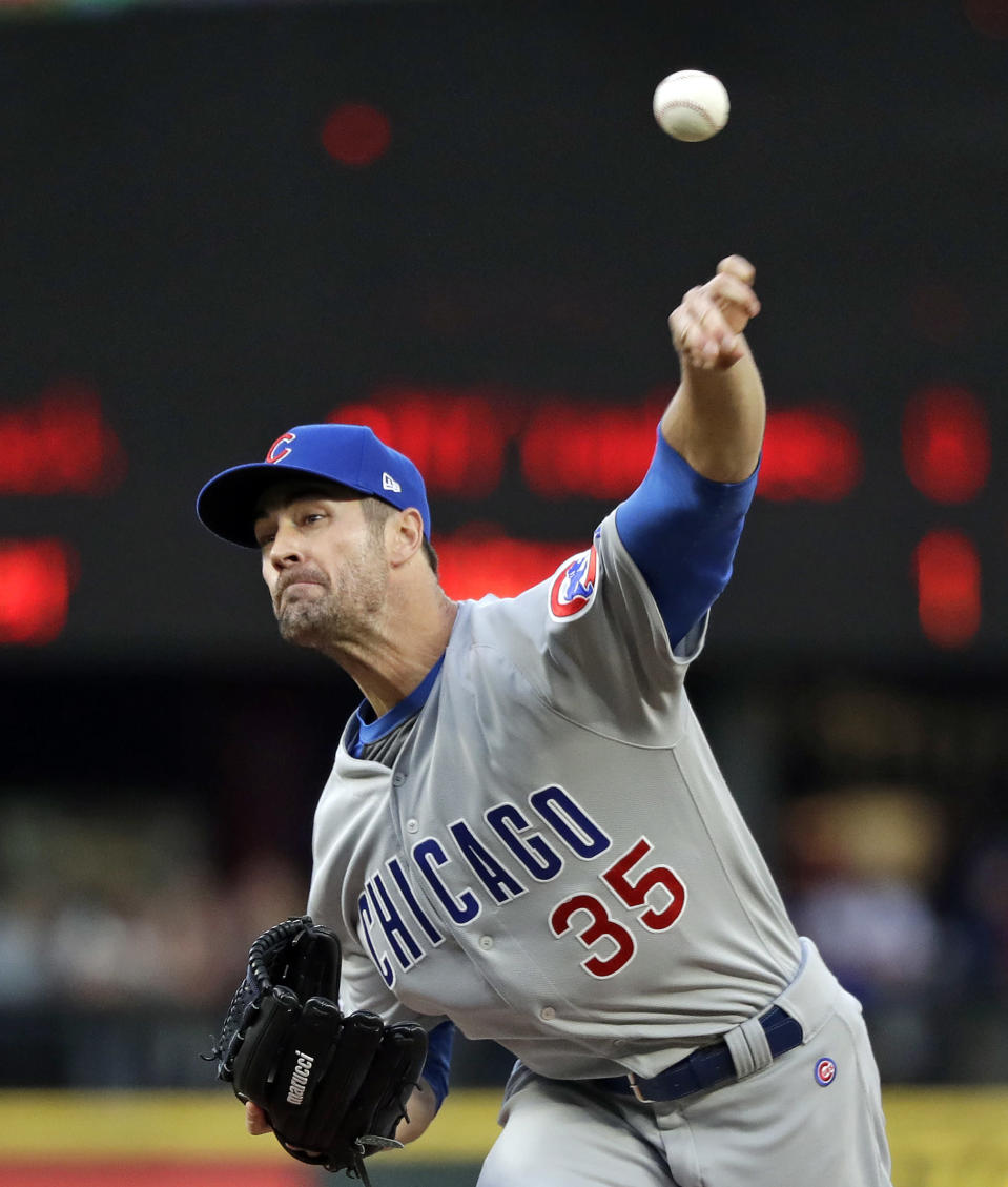 Chicago Cubs starting pitcher Cole Hamels throws to a Seattle Mariners batter during the first inning of a baseball game Tuesday, April 30, 2019, in Seattle. (AP Photo/Elaine Thompson)