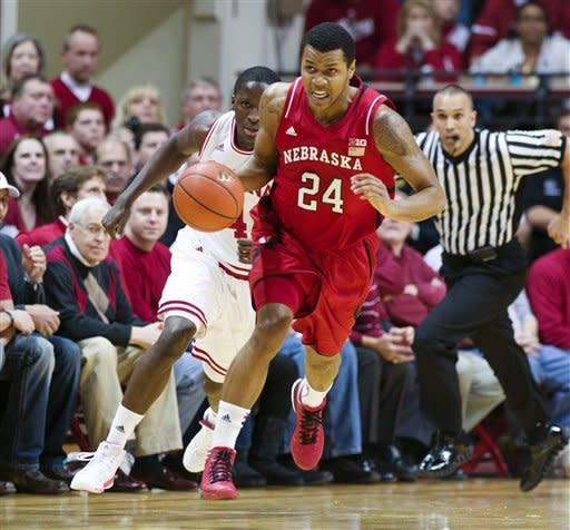 Nebraska's Dylan Talley (24) brings the ball upcourt during the first half of an NCAA college basketball game against Indiana, Wednesday, Feb. 13, 2013, in Bloomington, Ind. (AP Photo/Doug McSchooler)