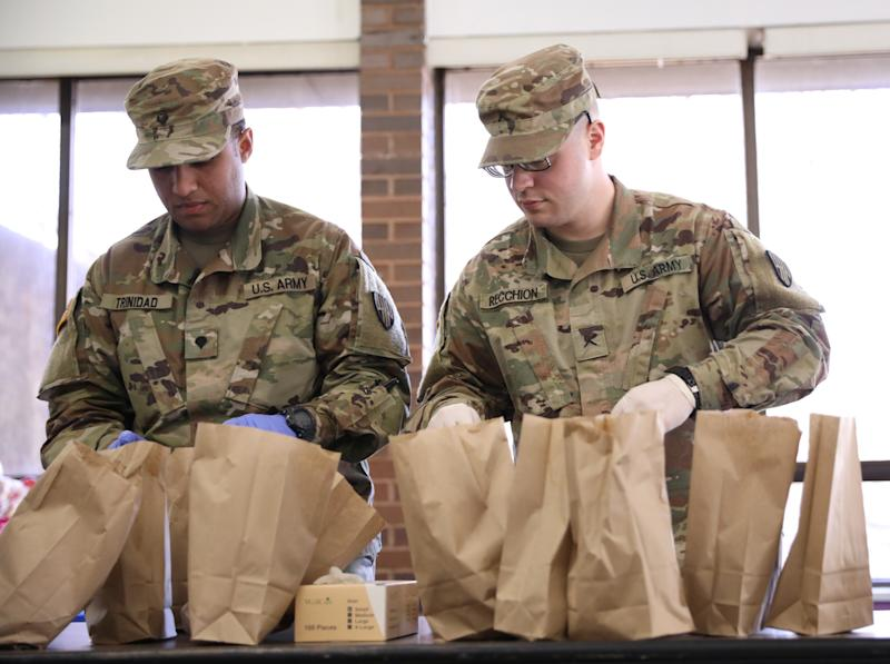 National Guard troops prepare food for distribution during the coronavirus outbreak in New Rochelle, New York, U.S., March 13, 2020. (Caitlin Ochs/Reuters)